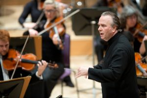Sir Mark Elder conducting the Hallé Orchestra